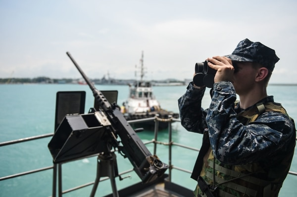 160424-N-KM939-010 SOUTH CHINA SEA (April 24, 2016) - Aviation Ordnanceman Airman Brandon Ellington, from Pierra, La., stands a gun mount watch on USS John C. Stennis' fantail during sea and anchor detail. Providing a ready force supporting security and stability in the Indo-Asia-Pacific, John C. Stennis is operating as part of the Great Green Fleet on a regularly scheduled 7th Fleet deployment. (U.S. Navy photo by Mass Communication Specialist 3rd Class David Cox / Released)