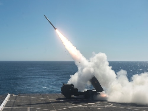 The High Mobility Artillery Rocket System is fired from the flight deck of the amphibious transport dock ship Anchorage (LPD 23) over the Pacific Ocean, Oct. 22, 2017. (Mass Communication Specialist 2nd Class Matthew Dickinson/Navy)