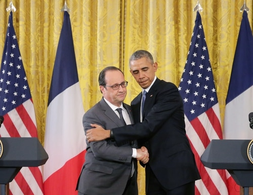 WASHINGTON, DC - NOVEMBER 24: French President Francois Hollande (L) and U.S. President Barack Obama embrace during a joint news conference at the White House November 24, 2015 in Washington, DC. Eleven days since coordinated terror attacks left 129 people dead in Paris, Hollande and Obama met in Washington in a show of solidarity and to continue their coordination in the military campaign against the Islamic State, or ISIS, the organization that claimed responsibility for the attacks. (Photo by Chip Somodevilla/Getty Images)