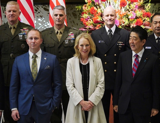 Merrill Eisenhower Atwater, the great-grandson of President Dwight Eisenhower, lower left, Mary Jean Eisenhower, Eisenhower's granddaughter, lower center, and Japan's Prime Minister Shinzo Abe, lower right, pose for a group photo session as part of the 60th anniversary commemorative reception of the signing of the Japan-U.S. Security Treaty at the Iikura Guesthouse in Tokyo, Sunday, Jan. 19, 2020. (Eugene Hoshiko/Pool via AP)