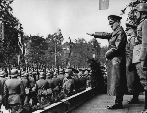 Adolf Hitler salutes parading troops of the German Wehrmacht in Warsaw, Poland, on Oct. 5, 1939. Germany invaded Poland on Sept. 1, 1939, 80 years ago. (AP)
