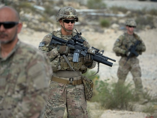 US soldiers part of NATO patrol during the final day of a month long anti-Taliban operation by the Afghan National Army (ANA) in various parts of eastern Nangarhar province, at an Afghan National Army base in Khogyani district on August 30, 2015. Afghan security forces launched a joint anti-militant operation in three districts, killing over 150 armed insurgents and wounding 112 others with 13 security personnel killed and three others were wounded in the past 30 days, Afghan National Army Commander Zaman Waziri said. AFP PHOTO / Noorullah Shirzada (Photo credit should read Noorullah Shirzada/AFP/Getty Images)