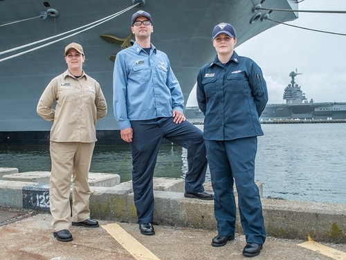 Left to right: Chief Logistics Specialist (AW/SW/IW) Tracy Riberdy, Logistics Specialist 1st Class (AW/SW) Sonny Williams and Information Systems Technician 2nd Class (IW) Chelsea Hanson model the three different color styles of the fire retardant at-sea test uniforms. (Mark D. Faram/Navy Times)