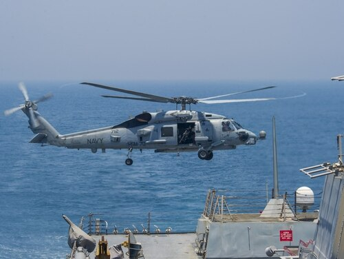 A MH-60R Seahawk helicopter takes off from the destroyer Truxton in 2014. (Navy)