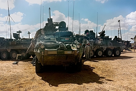 Soldiers from 1st Stryker Brigade Combat Team, 1st Armored Division operate Stryker vehicles equipped with Warfighter Information Tactical Increment 2 (WIN-T Inc 2) networked systems as part of the Network Integration Evaluation (NIE) 15.1 test for record taking place through the end of October 2014 at Fort Bliss, Texas. (Army)