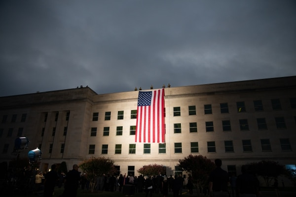 An American flag is displayed over the west wall of the Pentagon at the National 9/11 Pentagon Memorial at dawn on the 18th anniversary of the Sept. 11, 2001 terrorist attacks on New York, Washington, D.C., and Shanksville. Pa. (Mass Communication Specialist 1st Class Paul L. Archer/Navy)