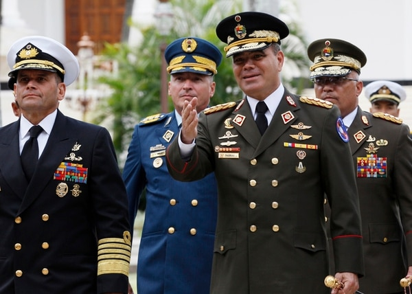 FILE - In this Aug. 8, 2017 file photo, Venezuela's Defense Minister Vladimir Padrino Lopez, center right, accompanied by a group of military commanders, arrives at the National Assembly building, in Caracas, Venezuela. (AP Photo/Ariana Cubillos, File)