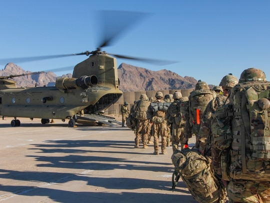 Soldiers attached to the 101st Resolute Support Sustainment Brigade load onto a Chinook helicopter in Afghanistan. (1st Lt. Verniccia Ford/Army)
