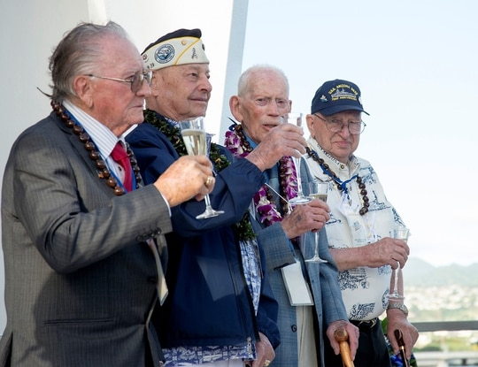 On Dec. 7, 2014, four of the then-nine remaining survivors from the battleship Arizona came together in Hawaii. Donald Stratton, left, Louis Conter, John Anderson, and Lauren Bruner, toasted in honor of fallen shipmates and service members of the Dec. 7, 1941, Japanese attack at Joint Base Pearl Harbor-Hickam. Stratton died Saturday at his Colorado home. (Navy)