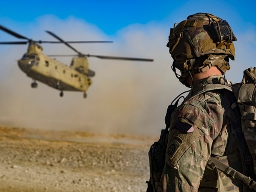 U.S. Army Staff Sgt. Jason N. Bobo watches as a CH-47 Chinook helicopter prepares to land in preparation for the extraction of Afghan and U.S. soldiers following a key leader engagement Dec. 29, 2019, in southeastern Afghanistan. (Master Sgt. Alejandro Licea/Army)