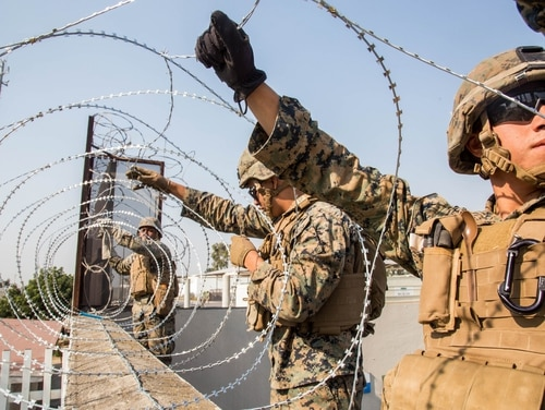 Marines place concertina wire at the Otay Mesa Port of Entry in California on Nov. 11, 2018. (Staff Sgt. Rubin J. Tan/Marine Corps)