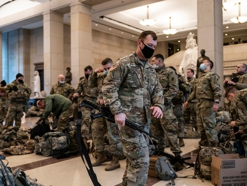 Hundreds of National Guardsmen hold inside the Capitol Visitor's Center to reinforce security at the Capitol in Washington Wednesday. (J. Scott Applewhite/AP)