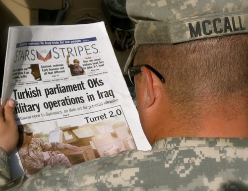 U.S. Army Sgt. Roger McCall, 153rd Military Police Company, reads an edition of the Stars and Stripes newspaper while in the Green Zone, Baghdad, Oct. 18, 2007. The 153rd MP Company is a unit of the Delaware Army National Guard currently assigned to the 89th MP Brigade. (U.S. Army National Guard photo by Sgt. Brendan Mackie/Released)