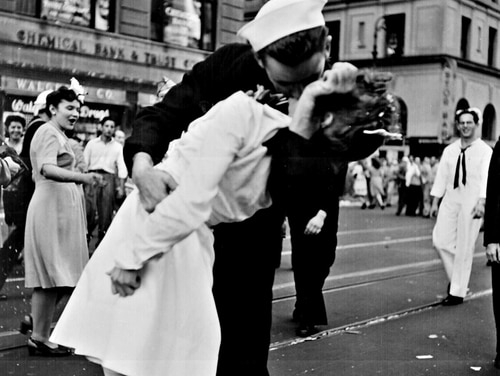 New York (Aug. 14, 1945) The kiss heard 'round the world, which has now been proven scientifically to be Quartermaster 1st Class George Mendonsa and dental assistant Greta Zimmer Friedman. The iconic and now sometimes controversial photograph has become a symbol of joy and relief through the years. (photo by Lt. Victor Jorgensen/Navy)