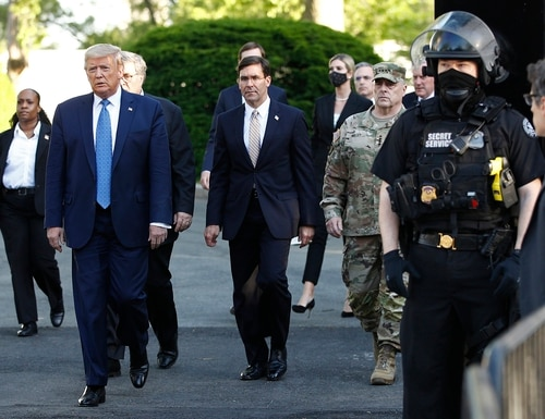 On June 1, 2020, President Donald Trump is accompanied to a photo op by Defense Secretary Mark Esper and Gen. Mark Milley, chairman of the Joint Chiefs of Staff. The event set off a wave of criticism for the military leaders. (Patrick Semansky/AP)