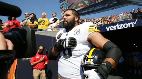 Pittsburgh Steelers offensive tackle and former Army Ranger Alejandro Villanueva stands outside the tunnel alone during the national anthem before a football game against the Chicago Bears on Sunday in Chicago. (Nam Y. Huh/AP)