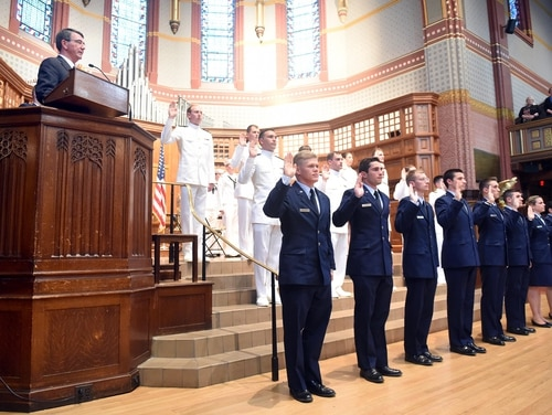 Defense Secretary Ashton Carter, upper left, reads the Oath of Office to graduates of the Air Force and Naval ROTC program at his alma mater, Yale University, at a Joint Military Commissioning Ceremony at Yale University's Battell Chapel in New Haven, Conn., Monday, May 23, 2016. Carter handed out commissions Monday to the Yale's first ROTC graduating class in more than four decades. (Arnold Gold/New Haven Register via AP) MANDATORY CREDIT