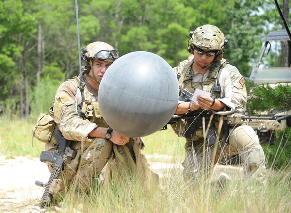 Special operations weather team members of the 10th Combat Weather Squadron prepare to release a weather balloon during a July 2013 training exercise at the Eglin Range, Fla. SOWTs provide immediate and accurate weather information and forecasts deep behind enemy lines. (Capt. Victoria Porto/Air Force)