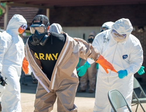 Sgt. Mason Moscatiello, a disinfection team specialist for Team 3 with Task Force 31, goes through the decontamination process on May 1, 2020, in Aliceville, Ala. (Sgt. Jaccob Hearn/Army)