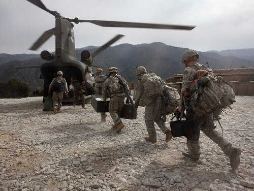 U.S. soldiers board an Army Chinook transport helicopter after it brought fresh soldiers and supplies to the Korengal Outpost on Oct. 27, 2008, in the Korengal Valley, Afghanistan. (John Moore/Getty Images)
