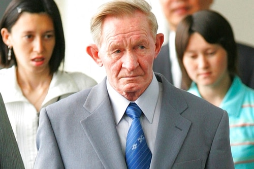 In this June 14, 2005, file photo, former U.S. Army deserter to North Korea, Charles Jenkins, together with his daughters Mika, rear left, and Brinda at Narita International Airport, east of Tokyo. (Itsuo Inouye/AP)