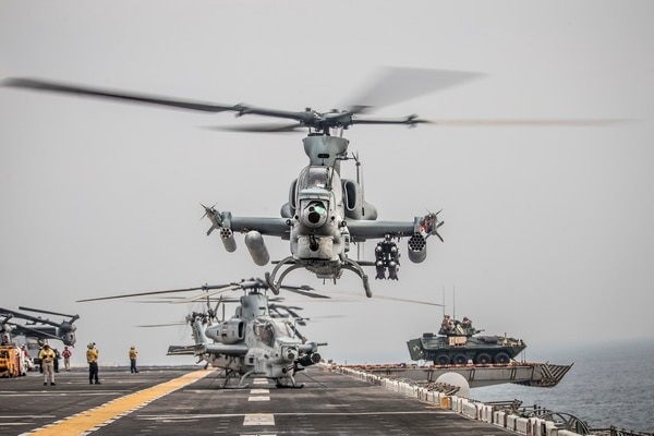 An AH-1Z Viper helicopter takes off Aug. 12, 2019, during a Strait of Hormuz transit aboard the amphibious assault ship USS Boxer (LHD 4). (Lance Cpl. Dalton S. Swanbeck/Marine Corps)