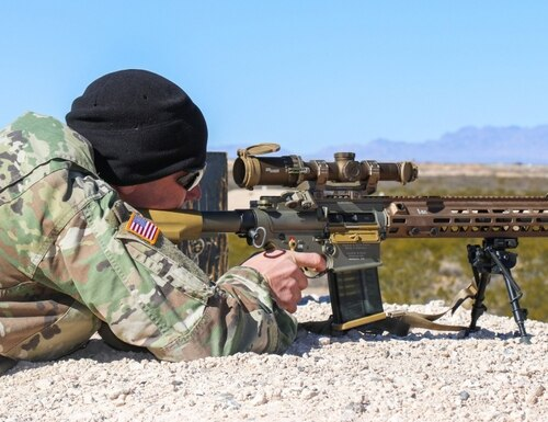A soldier takes aim with a Squad Designated Marksman Rifle featuring a Sig Scope (US Army photo by Staff Sgt. Kimberly Jenkins)
