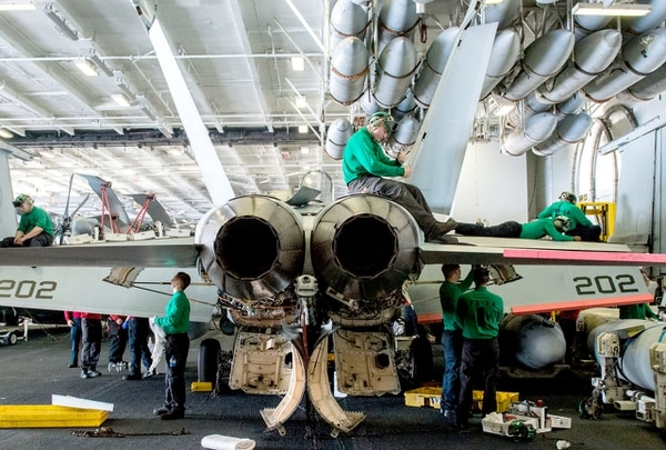 Sailors perform maintenance on an F/A-18E Super Hornet. (MCSN Tomas Compian/U.S. Navy)