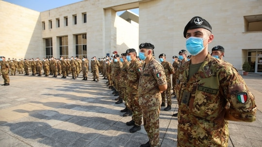 Italian soldiers stand at attention during the speech of Prime Minister Giuseppe Conte during a tour of a field hospital at the Lebanese University campus in the town of Hadath, north of the capital Beirut, on Sept. 8, 2020. (Anwar Amro/AFP via Getty Images)