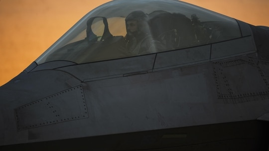 An F-22 Raptor pilot assigned to the 1st Fighter Wing, Joint Base Langley-Eustis, Va., conducts a preflight check at Spangdahlem Air Base, Germany, Oct. 13, 2017. (Staff Sgt. Jonathan Snyder/Air Force)