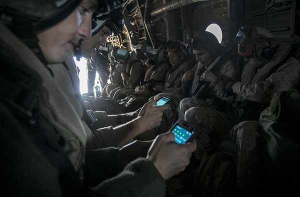 U.S. Marines with the 15th Marine Expeditionary Unit, test out their tablets aboard a MV-22B Osprey, during Certification Exercise (CERTEX) off the coast of San Diego, April 19, 2015. The Osprey has been fitted with a system of systems that provides small unit leaders with increased situational awareness and enhanced command and control capabilities at extended ranges. (U.S. Marine Corps photo by Cpl. Elize McKelvey/Released)