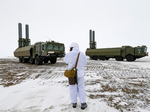 An officer speaks on a walkie-talkie as the Bastion anti-ship missile systems take positions on the Alexandra Land island near Nagurskoye, Russia, May 17, 2021. (Alexander Zemlianichenko/AP)