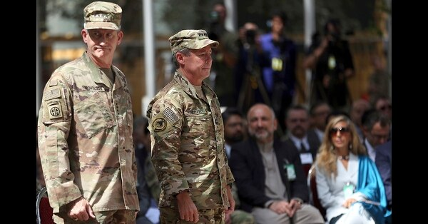 Outgoing U.S. Army Gen. John Nicholson, left, and incoming U.S. Army Gen. Austin Miller, second from left, prepare for the change of command ceremony at Resolute Support headquarters in Kabul, Afghanistan, Sunday, Sept. 2, 2018. Miller has assumed command of the 41-nation NATO mission in Afghanistan following a handover ceremony. (Massoud Hossaini/AP)
