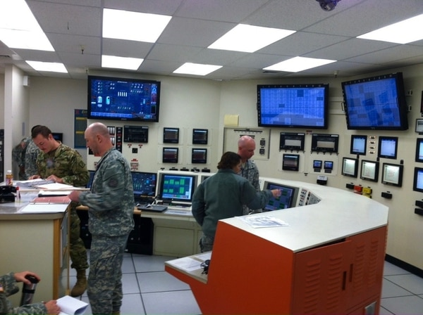 20th CBRNE Command's Nuclear Disablement Team members in a reactor control room simulator determine the necessary steps to safely shutdown the reactor at Idaho National Laboratory, Oct. 23, 2015.