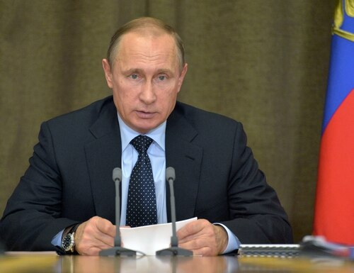 Russian President Vladimir Putin heads a meeting on military issues at the Russian Black Sea resort of Sochi, on Monday, Nov. 9, 2015. President Vladimir Putin says Russia's air campaign in Syria has proven the military's increased combat readiness and capability. (Alexei Druzhinin/RIA Novosti, Kremlin Pool Photo via AP)