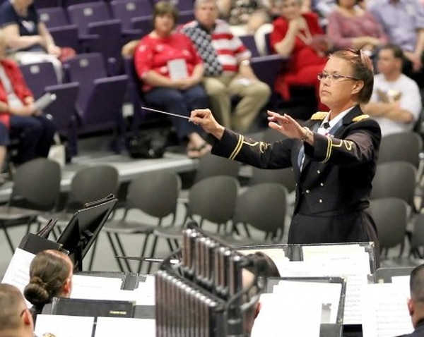 Chief Warrant Officer 5 Jeanne Pace, former bandmaster for the 1st Cavalry Division Band, conducts the God and Country Concert at the University of Mary Hardin Baylor center, June 28, 2013. The event takes place annually to help the city of Belton, Texas kick off their Fourth of July festivities. Pace is expected to retire during a ceremony July 10 on Cooper Field at Fort Hood, Texas, after more than 43 years of service. (U.S. Army courtesy photo, 1st Cav. Div. PAO (Released)