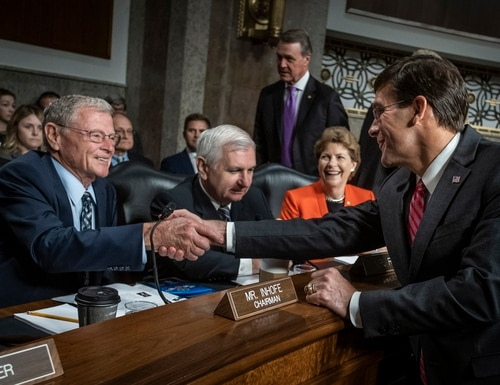 Secretary of Defense Mark Esper, shakes hands with Senate Armed Services Committee Chairman James Inhofe, R-Okla., before a July 16, 2019, hearing on Capitol Hill. The committee is planning