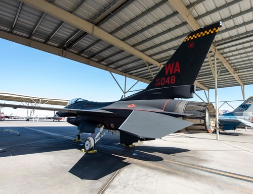 An F-16 fighter jet assigned to the 64th Aggressor Squadron sits on the flight line at Nellis Air Force Base, Nevada, Oct. 28, 2019. In order to gain more capacity, the Air Force has begun contracting with defense companies for adversary air services. (Senior Airman Miranda A. Loera/U.S. Air Force)