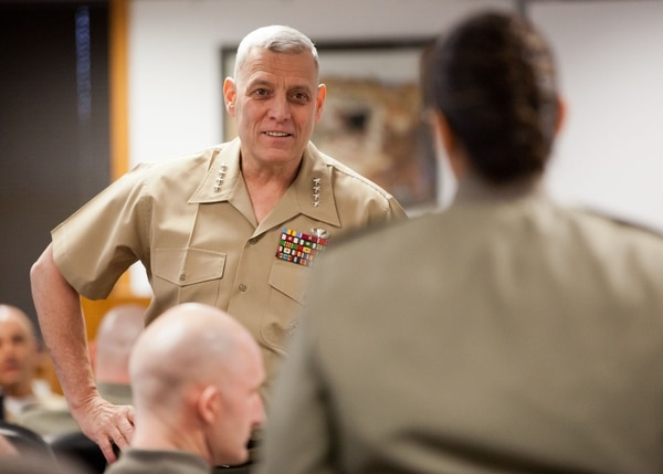 The Assistant Commandant of the Marine Corps, Gen. John M. Paxton, Jr., speaks with a Marine from the Senior Enlisted Professional Military Education Course aboard Marine Corps Base Quantico, Va., March 25, 2014. (U.S. Marine Corps photo by Cpl. Tia Dufour/Released)