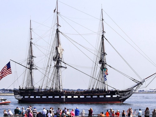 The U.S.S. Constitution, also known as Old Ironsides, floats past Fort Independence off the shore of Castle Island on a turnaround cruise in Boston on Friday. (Charles Krupa/AP)