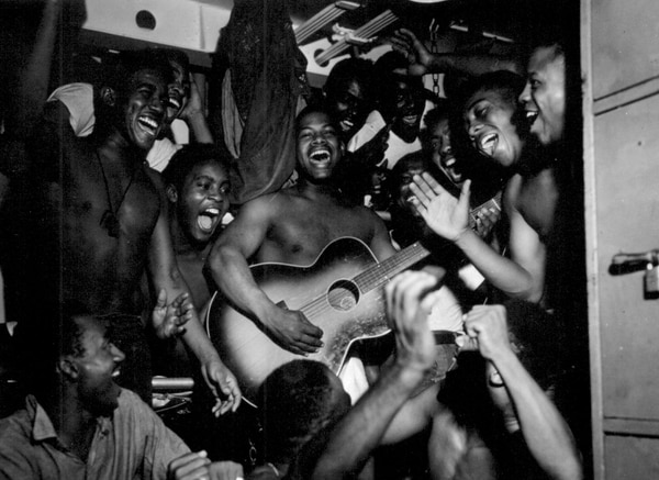 On Aug. 14, 1945, enlisted men on board the aircraft carrier Ticonderoga learn of Japan's surrender. (National Archives)