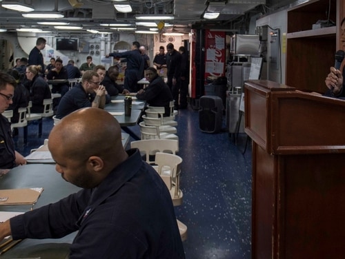 Sailors aboard the Bonhomme Richard take the E-5 advancement exam in early 2015 while the amphibious assault ship sailed the Philippine Sea. (MC2 Kyle Carlstrom/Navy)