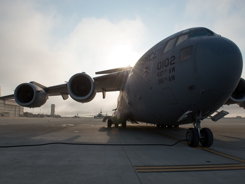 A C-17 Globemaster III sits on the tarmac at Travis Air Force Base, Calif. A driver who breached the main gate at Travis and then crashed was pronounced dead at the scene Wednesday evening. (Louis Briscese/Air Force)