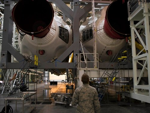 1st Lt. Drew Carrigan, 5th Space Launch Squadron Air Force Responsible Engineer, inspects a set Delta IV heavy boosters during a routine March 14 inspection at Cape Canaveral Air Force Station, Fla. (Airman 1st Class Dalton Williams/U.S. Air Force)