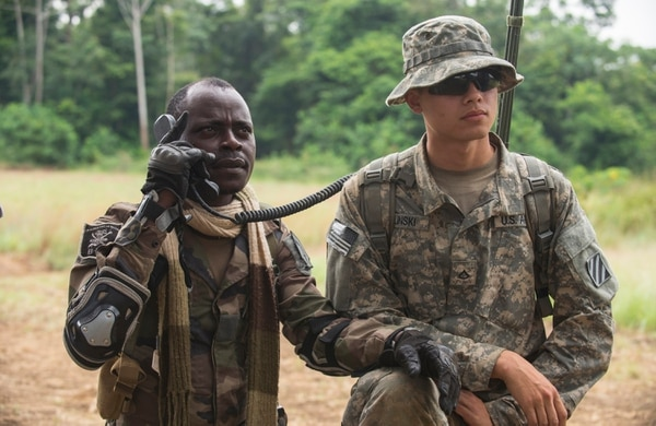 U.S. Army Pvt. 1st Class Jeremy Bielinski (right), an infantryman with the 3rd Battalion, 7th Infantry Regiment, 2nd Brigade Combat Team, 3rd Infantry Division, assists a Gabonese Soldier with radioing a simulated aeromedical evacuation during a Tactical Combat Casualty Care Course at this year's Central Accord exercise in Libreville, Gabon on June 17, 2016. U.S. Army Africa's exercise Central Accord 2016 is an annual, combined, joint military exercise that brings together partner nations to practice and demonstrate proficiency in conducting peacekeeping operations. (DoD News photo by TSgt Brian Kimball)