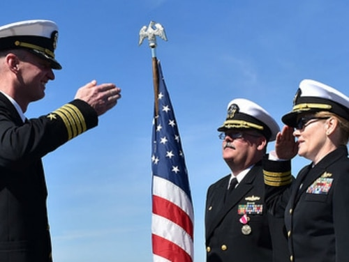 Cmdr. Tammy Royal, right, was relieved as commanding officer of the dock landing ship Harpers Ferry last week due to a loss of confidence in her ability to command, Navy officials confirmed. She is shown here taking command of the San Diego-based ship last year. (Navy)