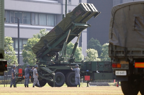 FILE - In this Tuesday, June 21, 2016 file photo, Japan Self-Defense Force members set up a PAC-3 Patriot missile unit deployed ahead of North Korea's planned rocket launch at the Defense Ministry in Tokyo. Japan has called North Korea's nuclear and missile development a