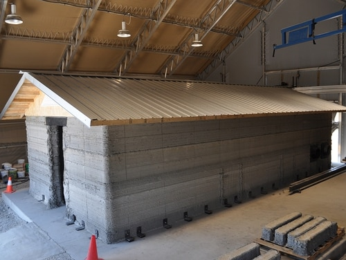 A barracks hut constructed with the Automated Construction of Expeditionary Structures is a new construction technology that prints concrete structures. This hut at the Construction Engineering Research Laboratory in Champaign, Ill., is seen on Aug. 18, 2017.
