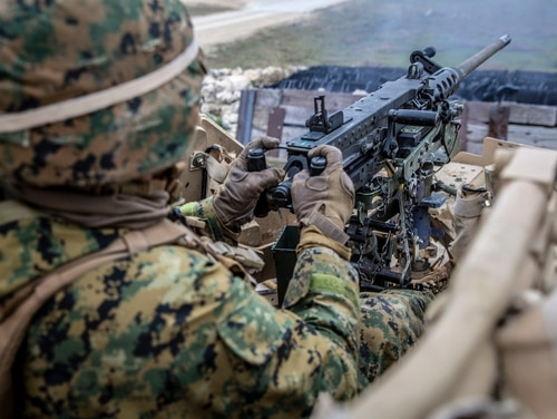 Marine Corps Cpl. Philip D. Bell, an antitank missile gunner with 1st Tank Battalion, 1st Marine Division, shoots a .50-caliber machine gun mounted on a Humvee during exercise Comanche Run at Fort Hood, Texas. (Lance Cpl. Sahara A. Zepeda/Marine Corps)