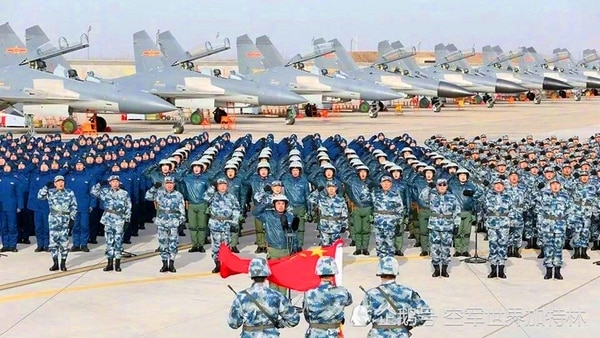 On display during a parade by the People's Liberation Army Air Force are Shenyang J-16s, foreground, and J-11Bs, background. (China's Ministry of National Defense)